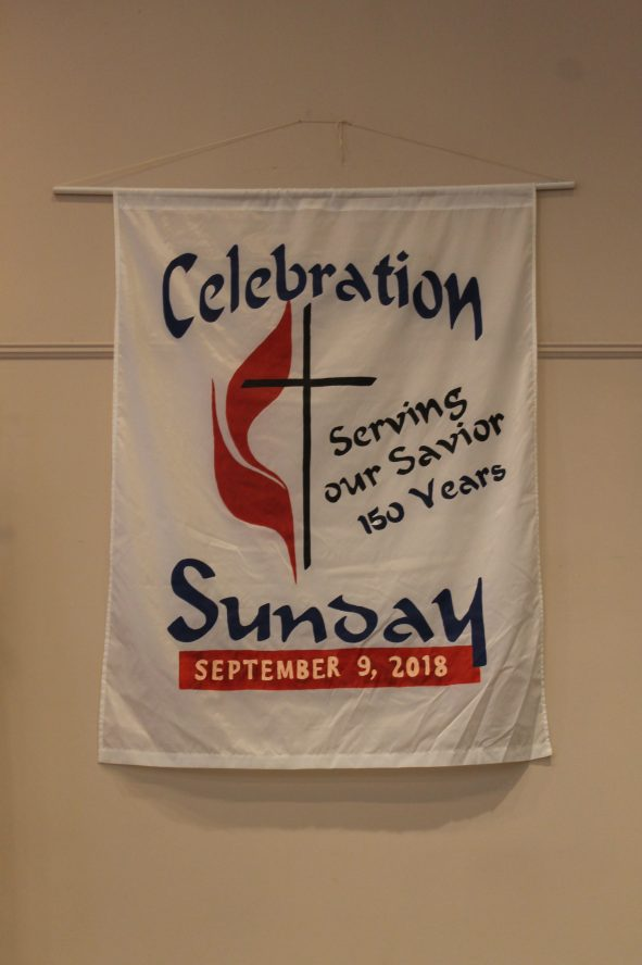 150th Anniversary banner hanging inside the church.