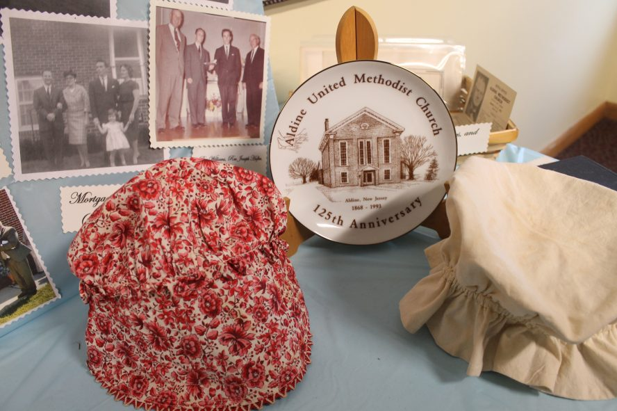 Aldine UMC commemorative plate along with old photos and ladies head wear